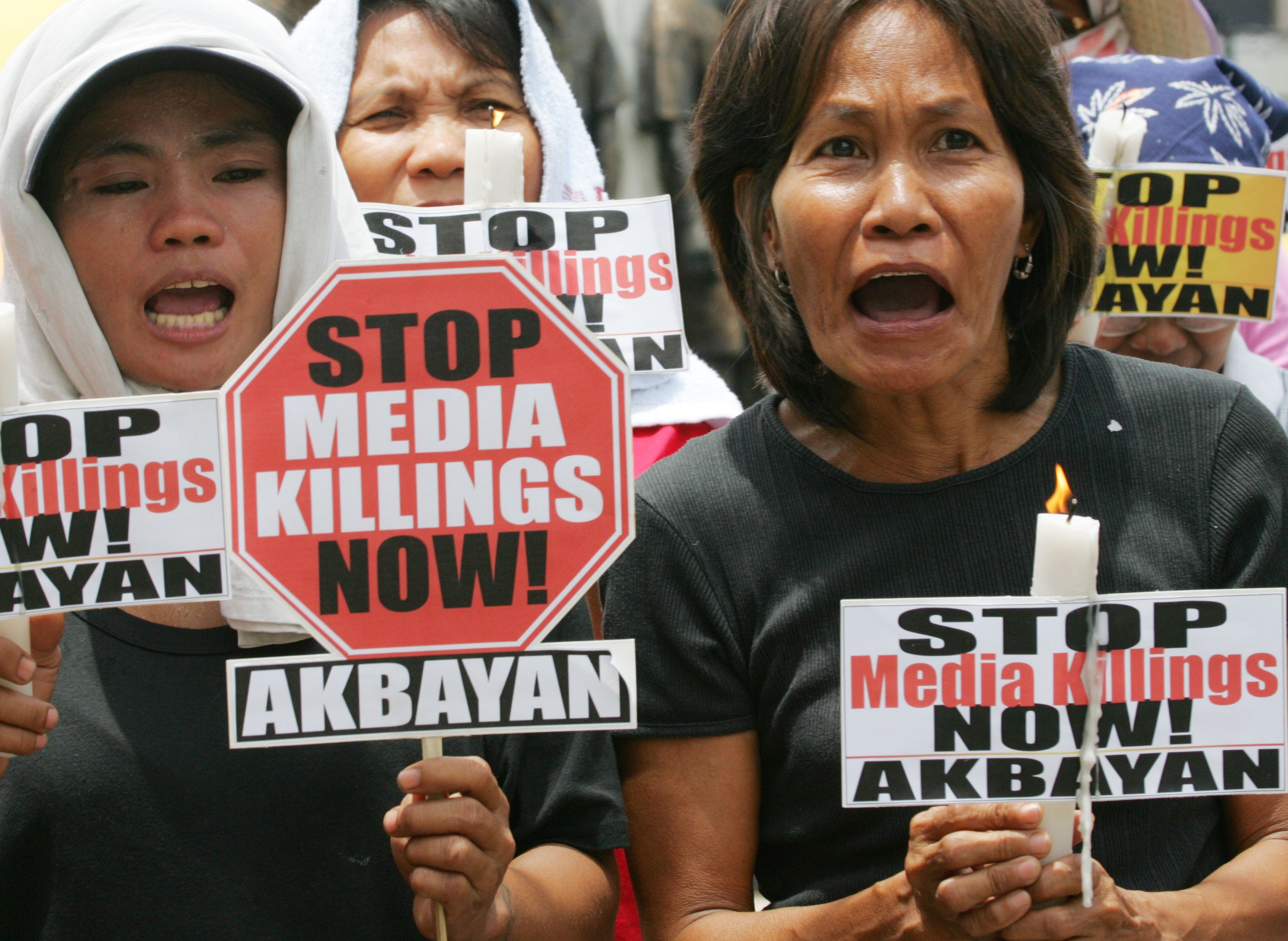 Protesters shout slogans during a rally at Quezon city, the Philippines, in 2006, to protest spate of killings of left-wing activists and journalists in the country. (AP Photo/Bullit Marquez)