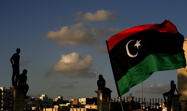 Libyans watch a protest against Ansar al-Shariah Brigades and other Islamic militias, in Benghazi, September 2012. (AP Photo/Mohammad Hannon)