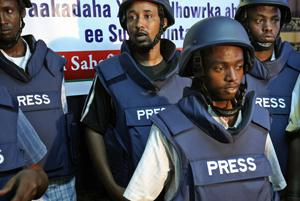 Journalists wear ballistic vests (CPJ)